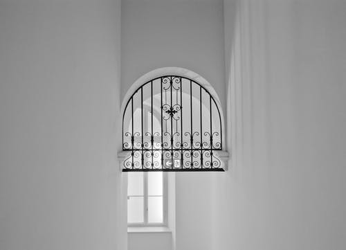 Black Metal Window Grill in Grayscale Photography