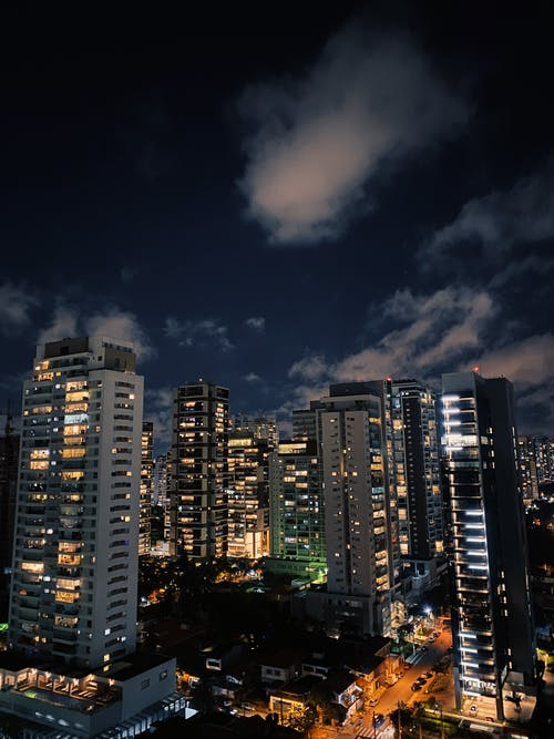 Tall skyscrapers in megapolis at night