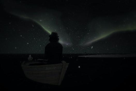 Free stock photo of man, boat, aurora borealis