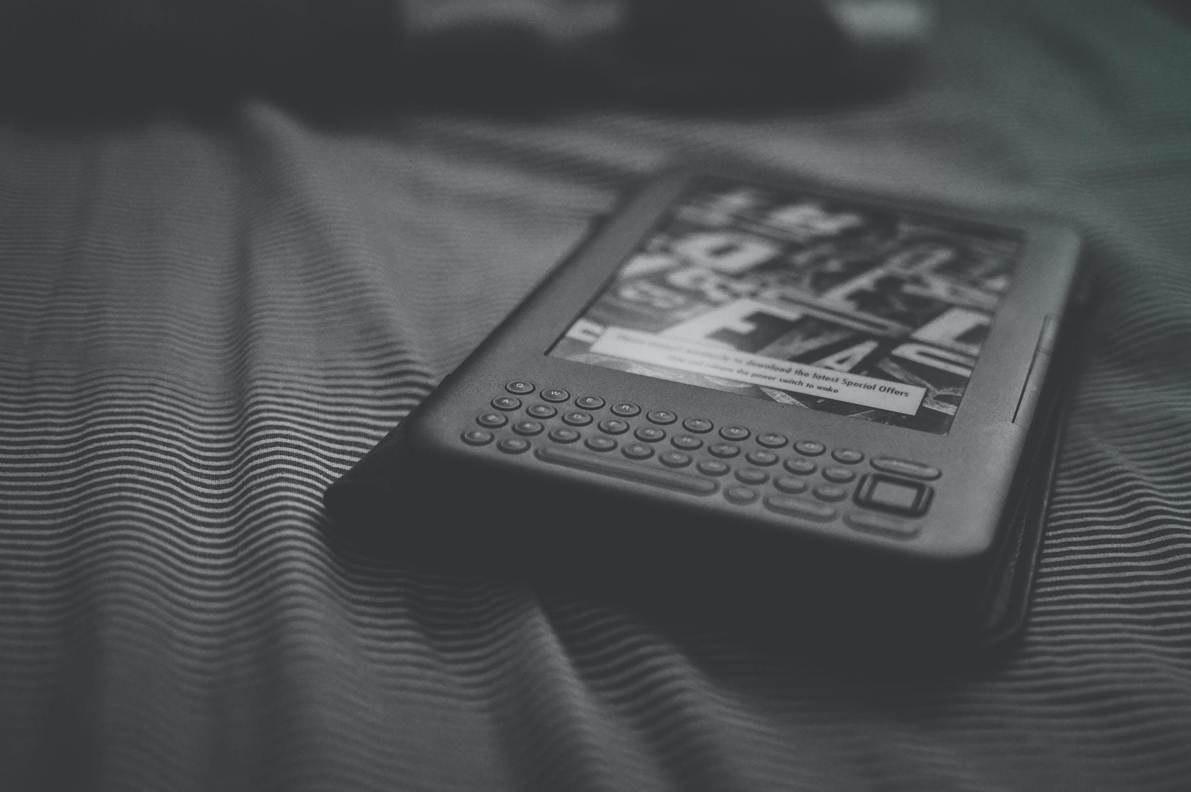 Grayscale Photo of E-reader