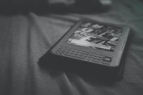 Grayscale Photo of E-reader