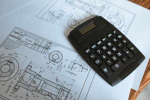 Black Calculator on White Paper