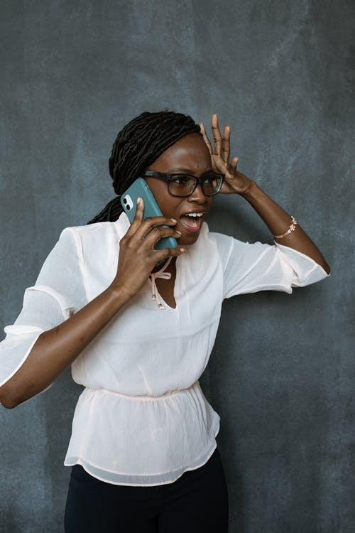 A Surprised Woman Using Cellphone