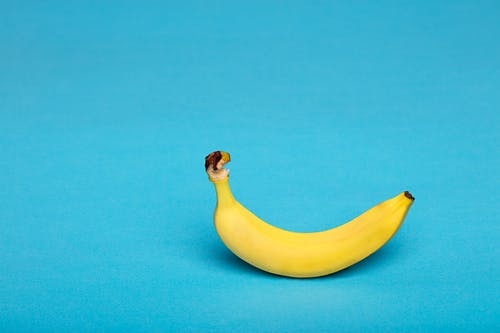 Yellow Banana Fruit on Blue Textile