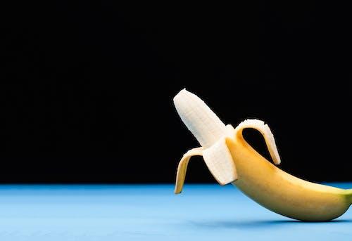 Yellow Banana Peel on Blue Surface