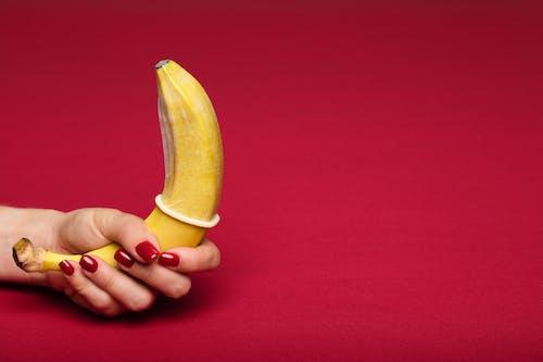 Yellow Banana with a Condom