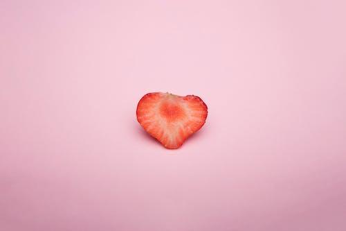 Sliced Strawberry Fruit on Pink Background
