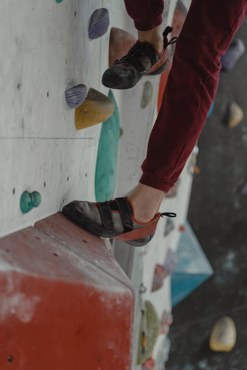 Person Climbing On A Rock Wall