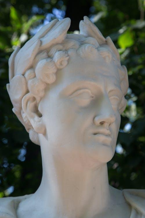 Low angle of sculpture of Roman emperor of antiquity with laurel wreath on head Summer Garden in Saint Petersburg