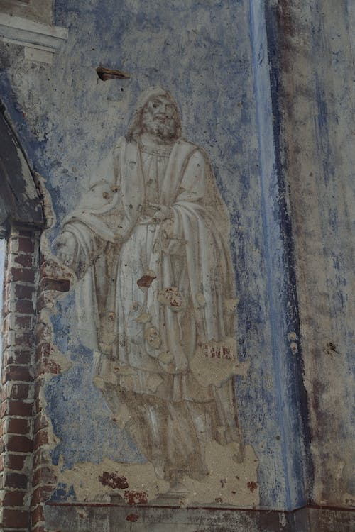 Fresco of saint apostle on wall of old temple
