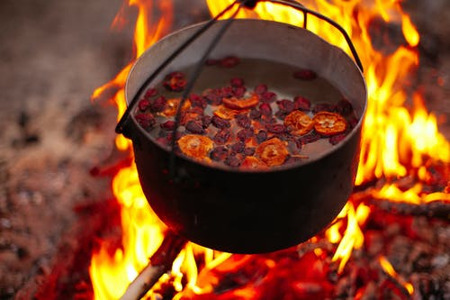 Black Cooking Pot With Red and Brown Food