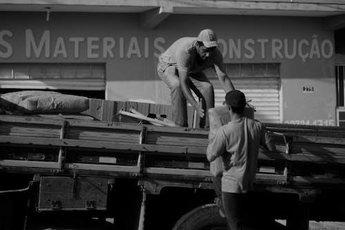 Men loading bags on truck