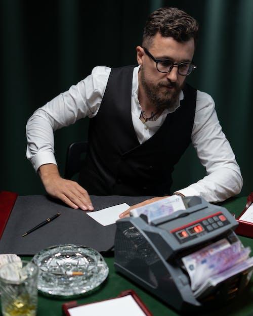 Clerk in Black Vest