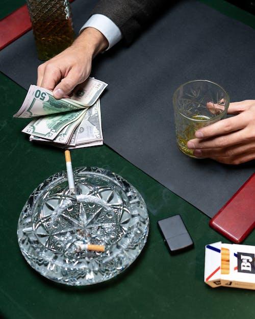 Person Holding 20 Us Dollar Bill