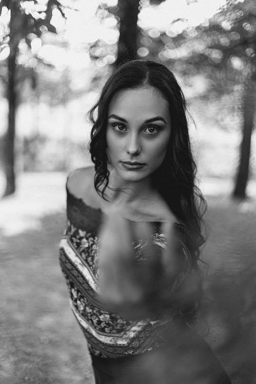 Attractive woman reaching hand on camera