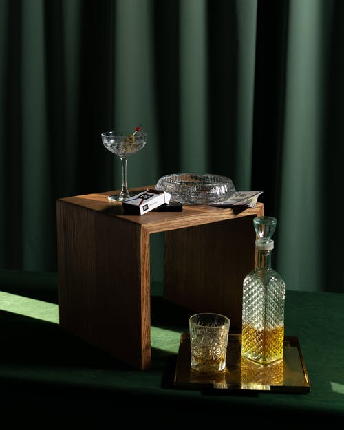 Clear Glass Vase on Brown Wooden Table