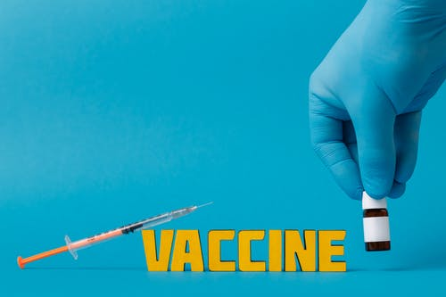 Covid Vaccine on Blue Surface