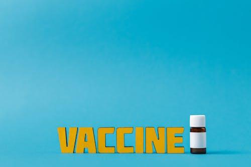 Vaccine Text Beside A Bottle