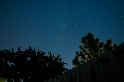 Free stock photo of astrophotography, fence, milky way, night photography