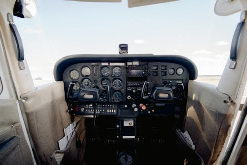 Interior of cabin with dashboard consisting of steering wheel sensors and buttons for aircraft control