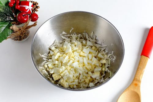 Chopped Boiled Eggs With Vegetable on Stainless Steel Bowl