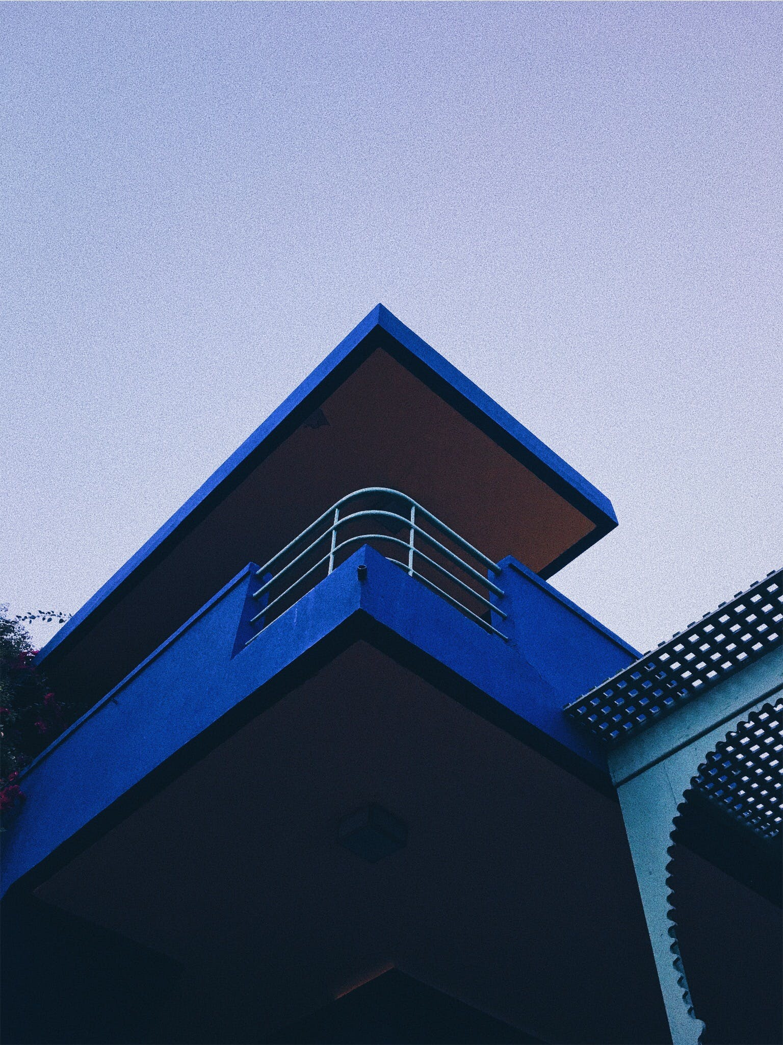 Low Angle Photography of Blue Concrete Building ]