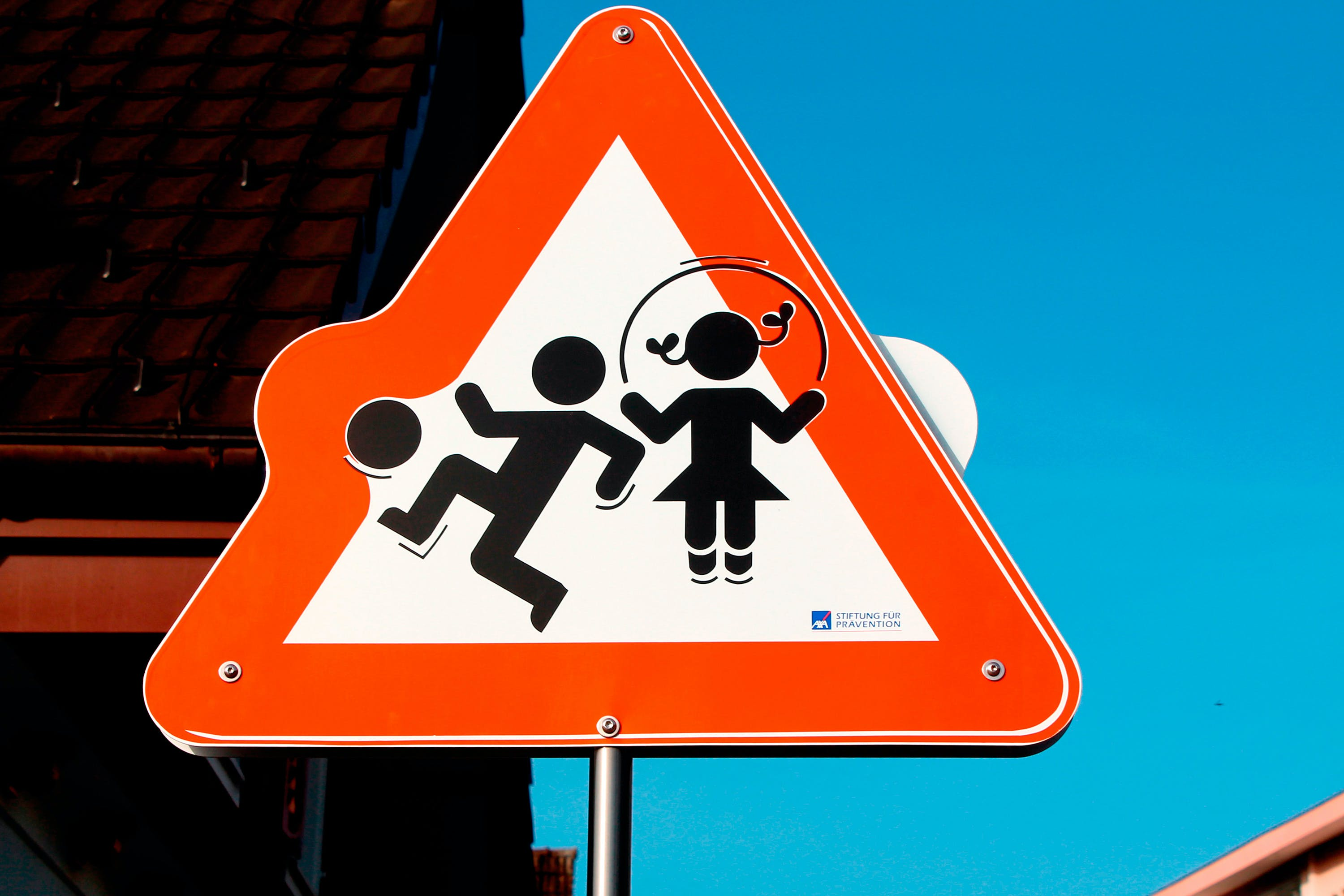 Red and White Children Playing Road Signage