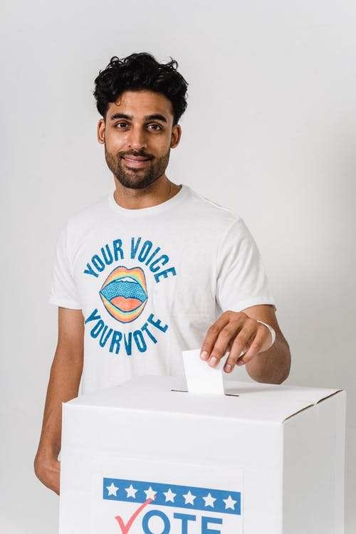 Photo Of Man Dropping His Vote On White Box