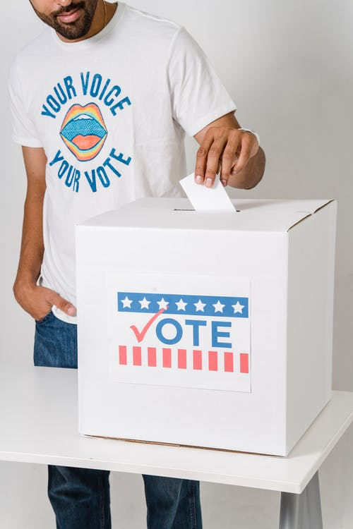 Photo Of Person Putting His Vote On The White Box