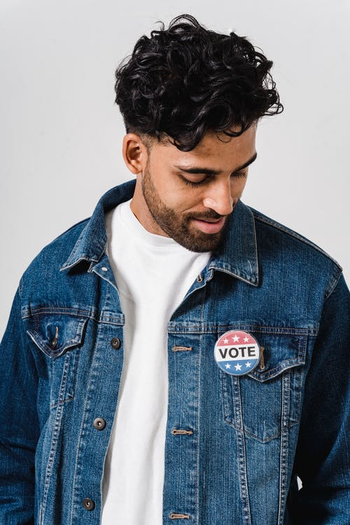 Photo Of Man With Pin Button On His Blue Denim Jacket