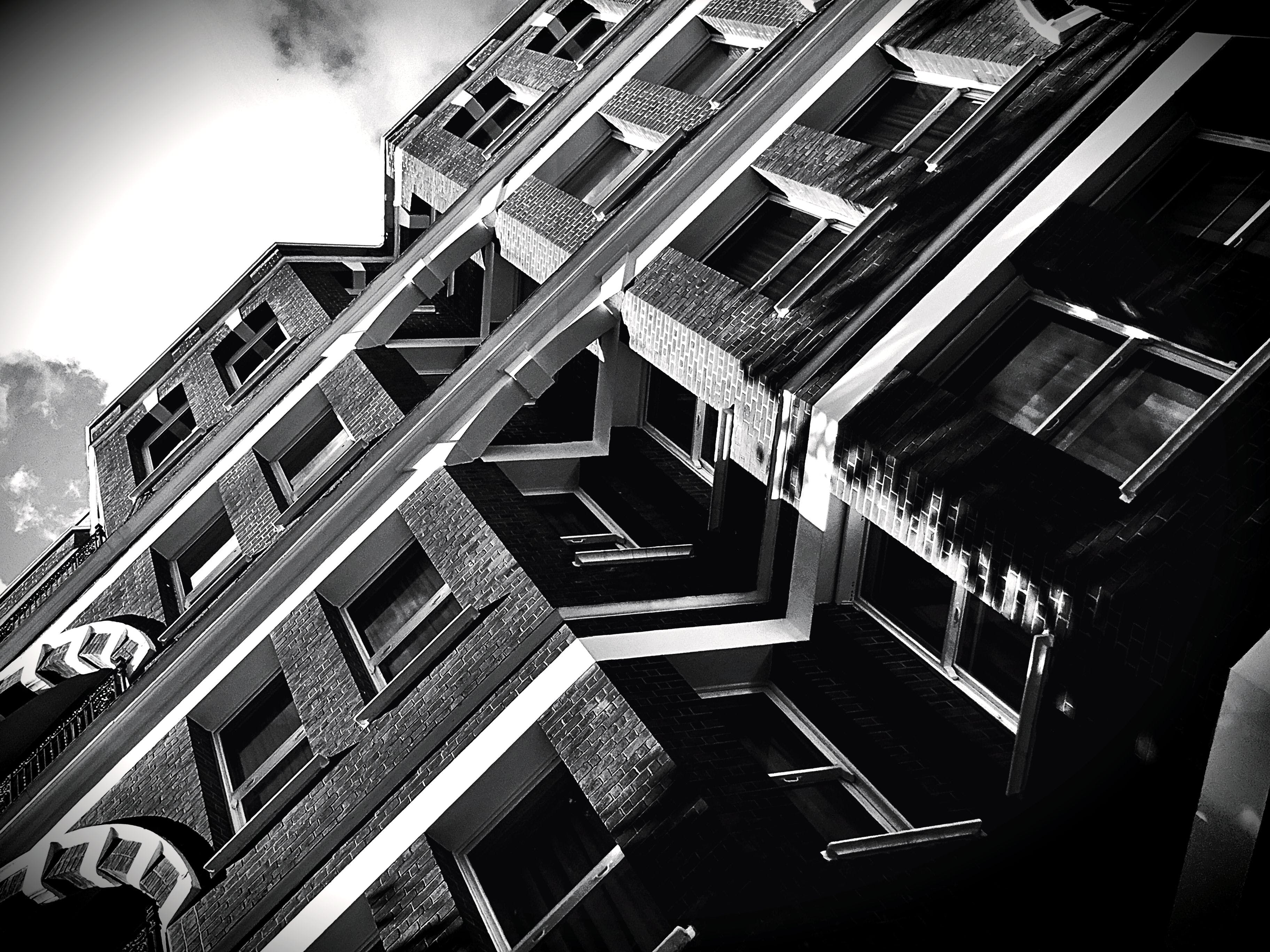 Grayscale and Low Angle Photography of High-rise Builinding