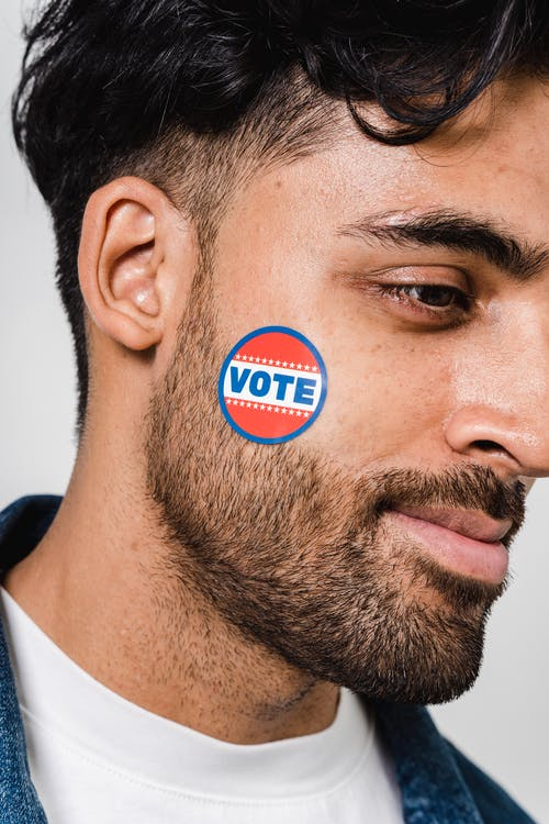 Side View Photo Of Man With Pin Vote On His Face