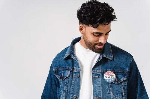 Photo Of Man With Pin Button On His Denim Jacket