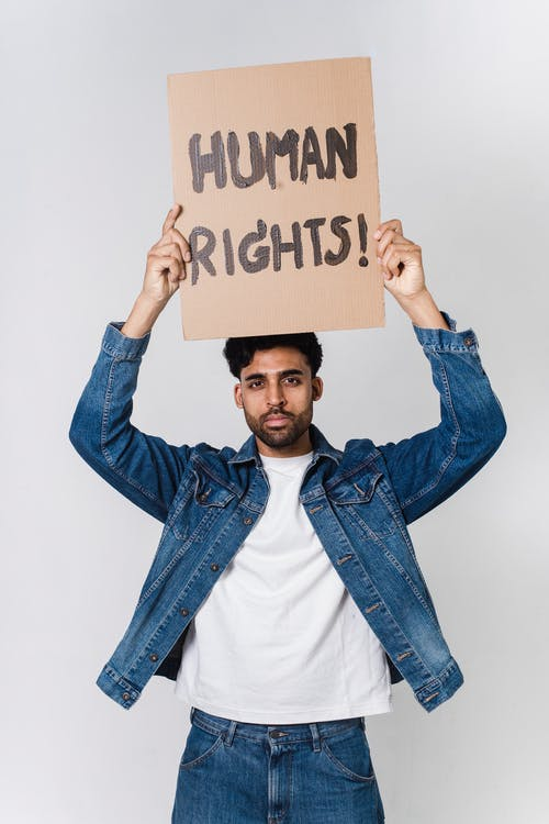 Photo Of Man Holding A Placard