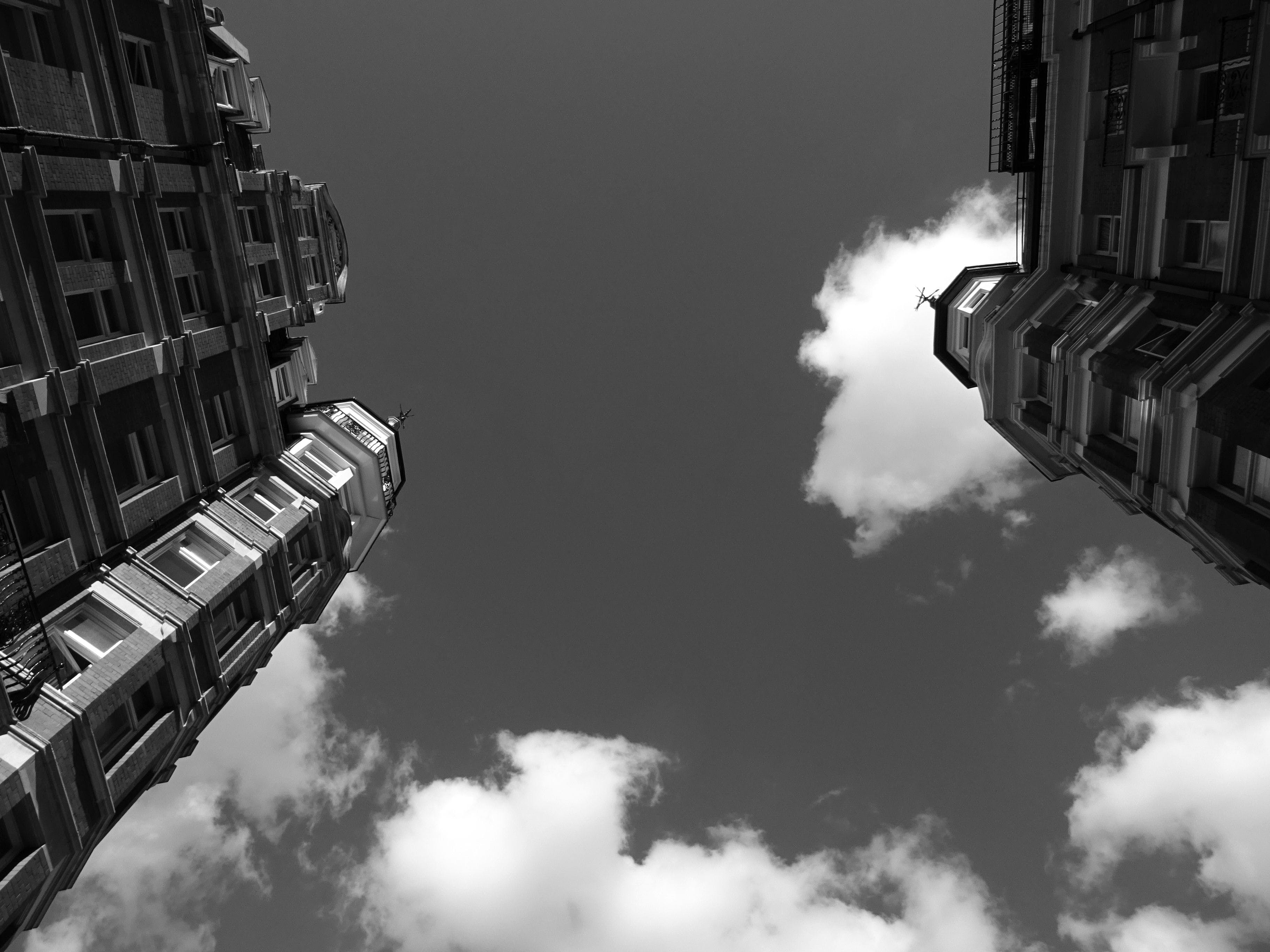 Grayscale and Low Angle Photography of Buildings