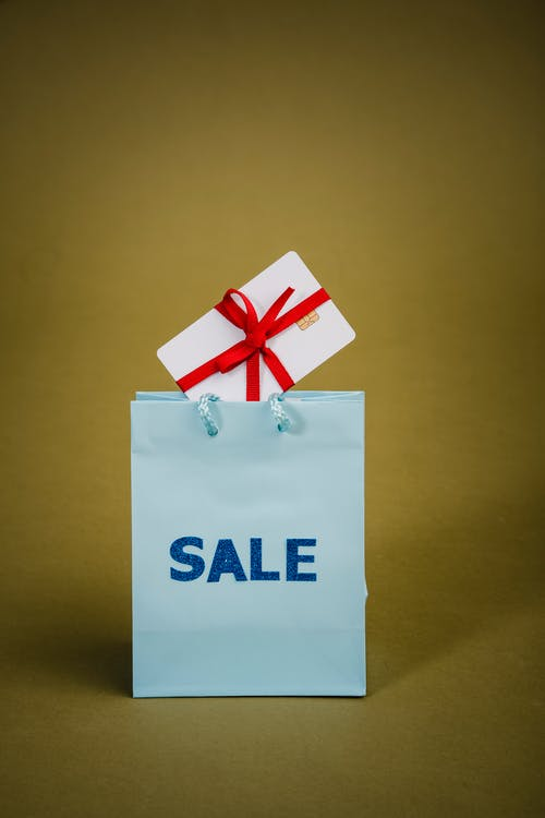 Verkaufstext Auf Blauer Papiertüte Mit Geschenkbox
