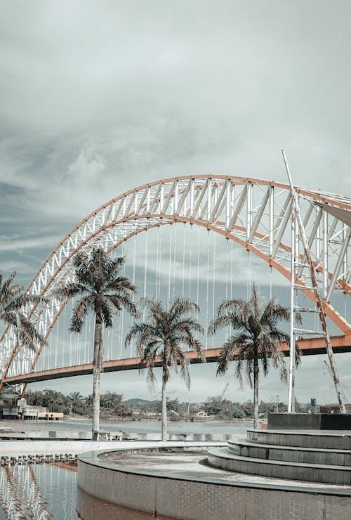 White Arch Bridge Under Cloudy Sky