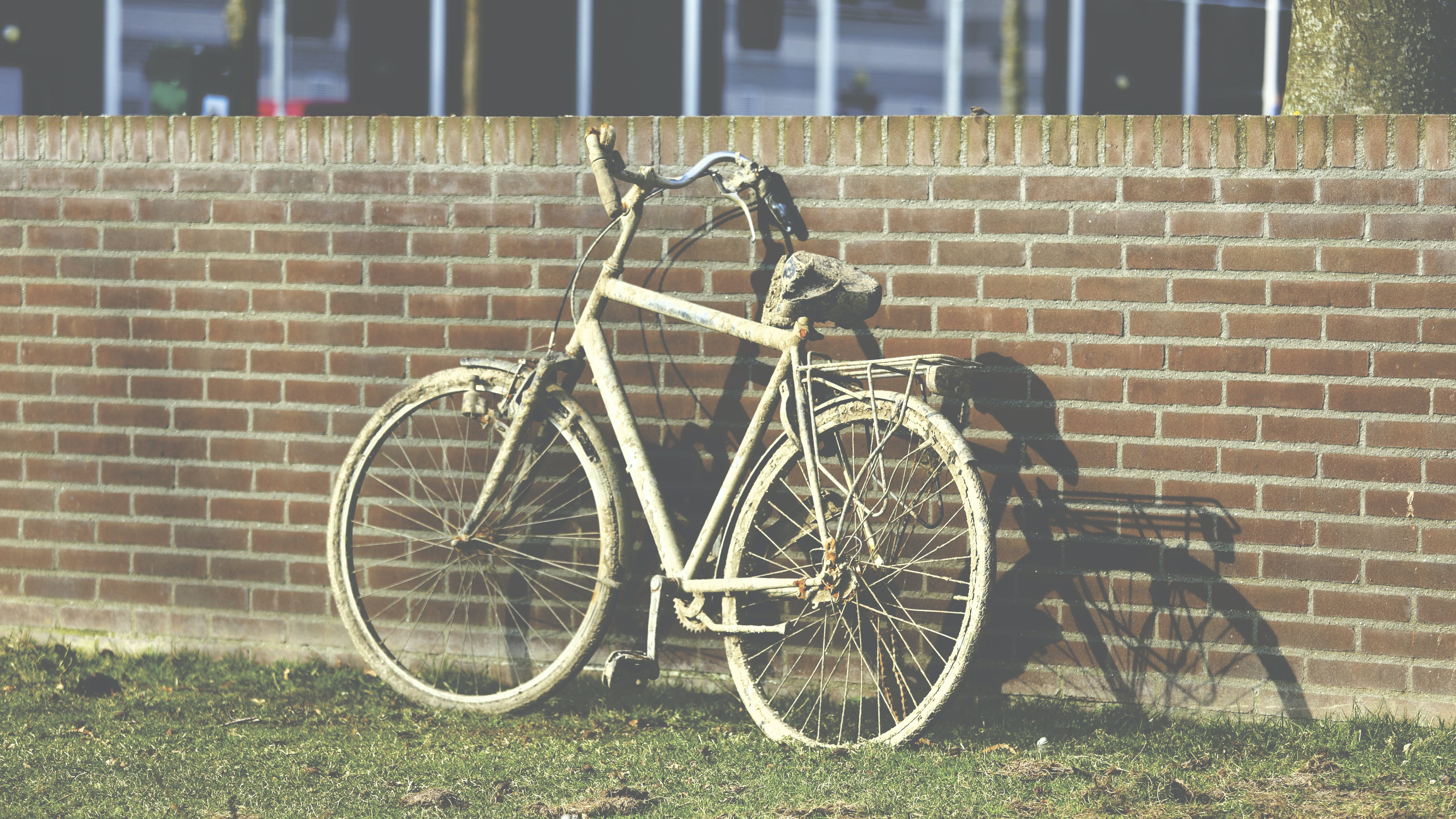 White Cruiser Bicycle Parked Beside Brown Building