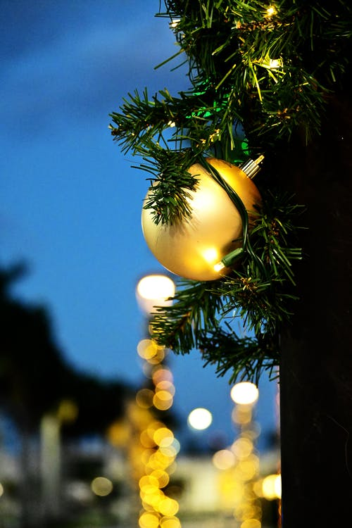 Green Christmas Tree With Yellow Bauble