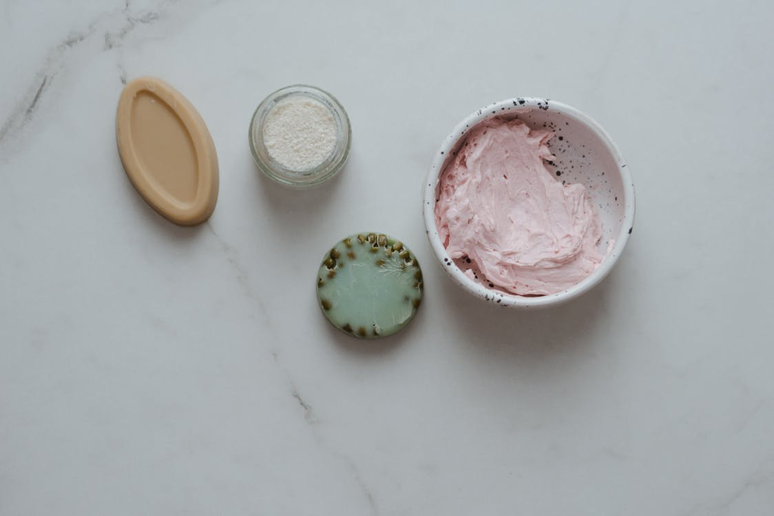 Cosmetic Products on White Table