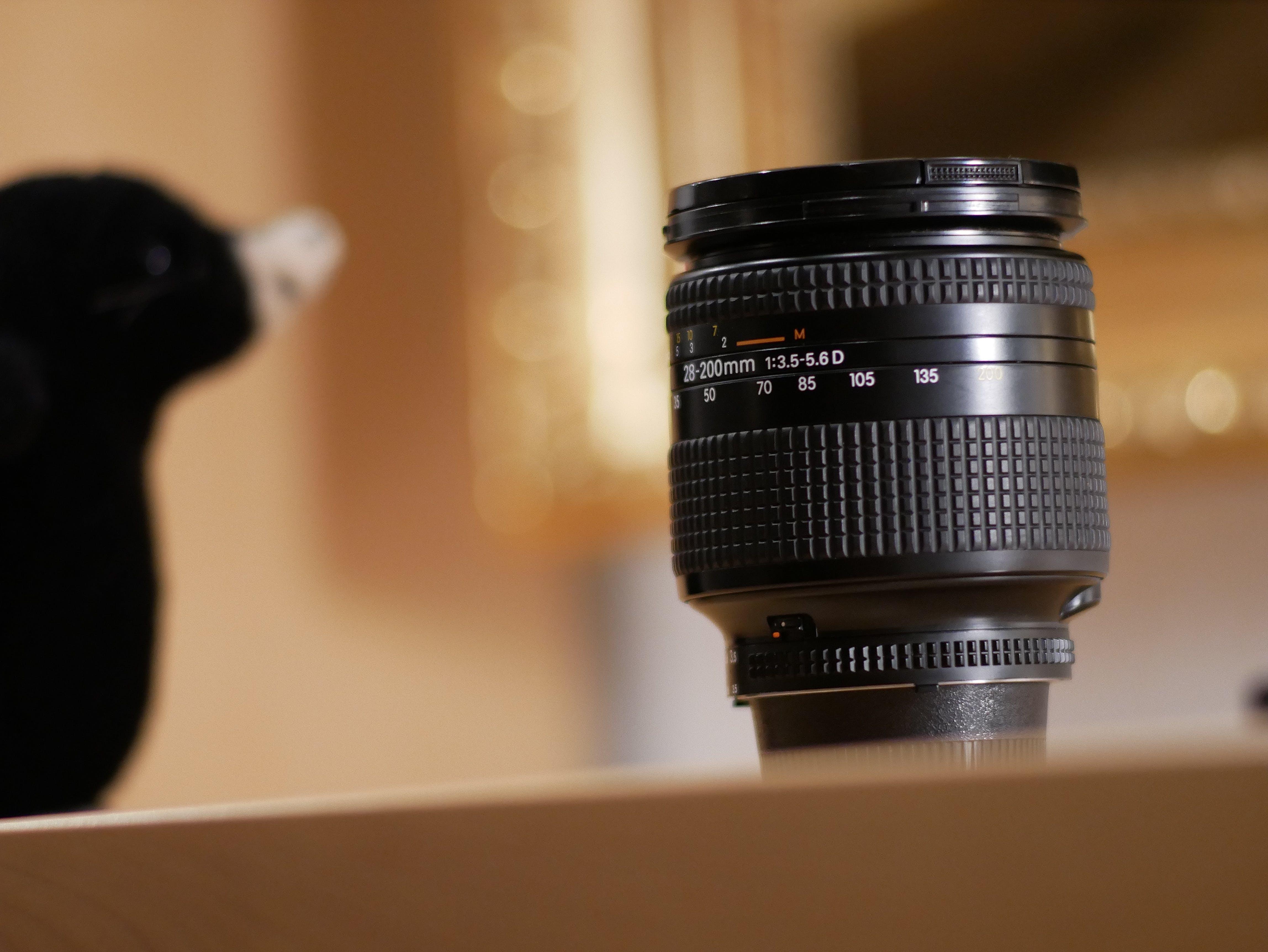 Black Camera Lens on Brown Surface