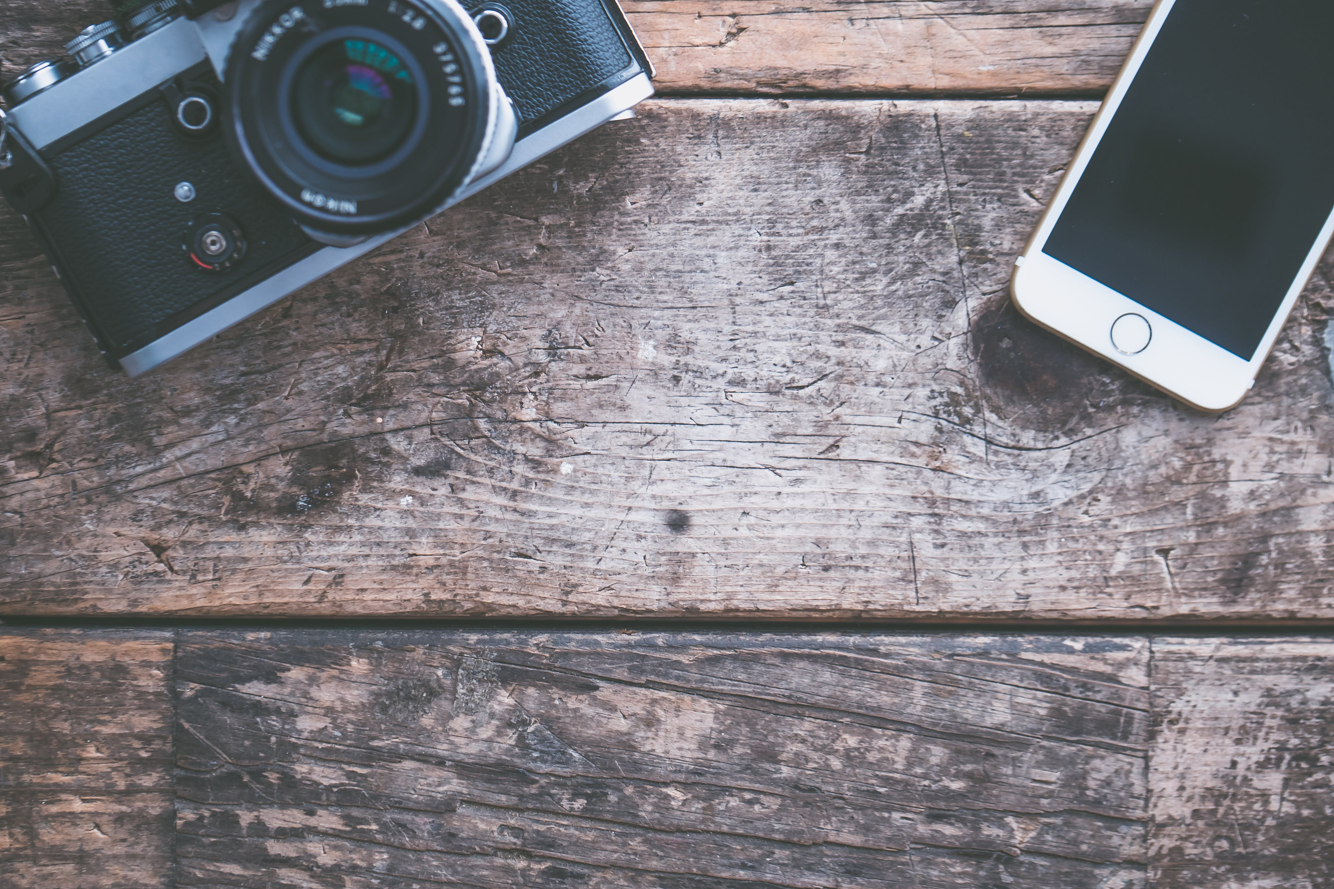 Flat-lay Photography of Point-and-shoot Camera and Iphone