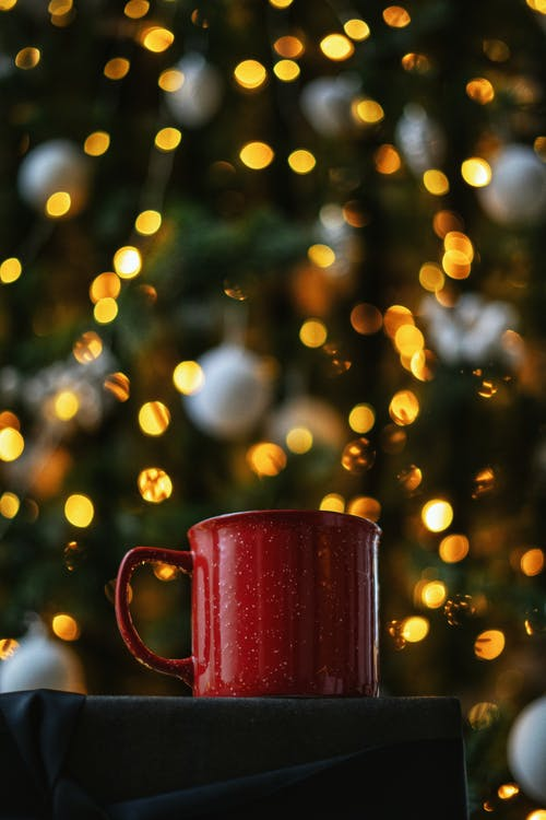 Red Ceramic Mug With Bokeh Lights