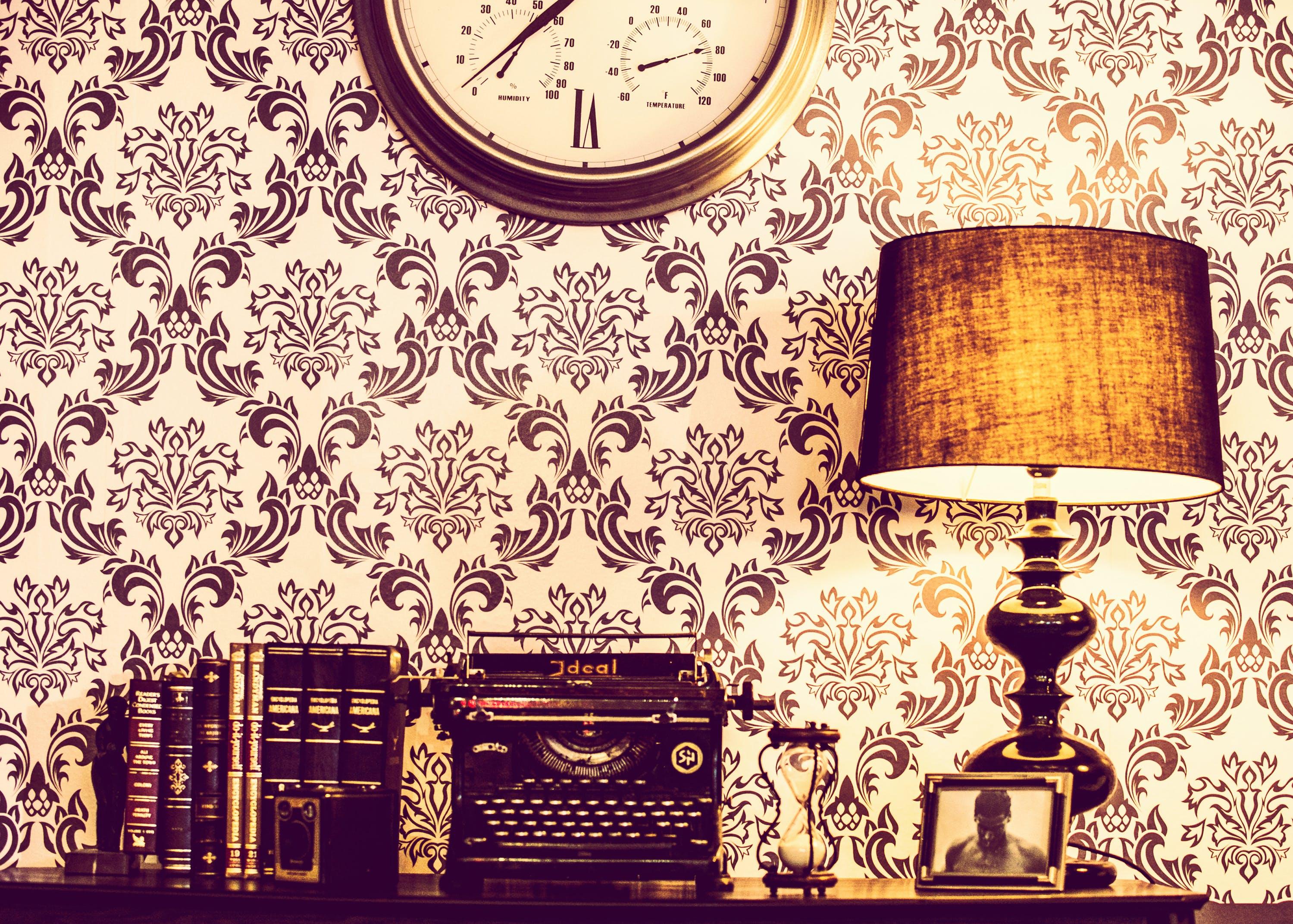 Brown Wooden Table Lamp Beside of Black Typwriter