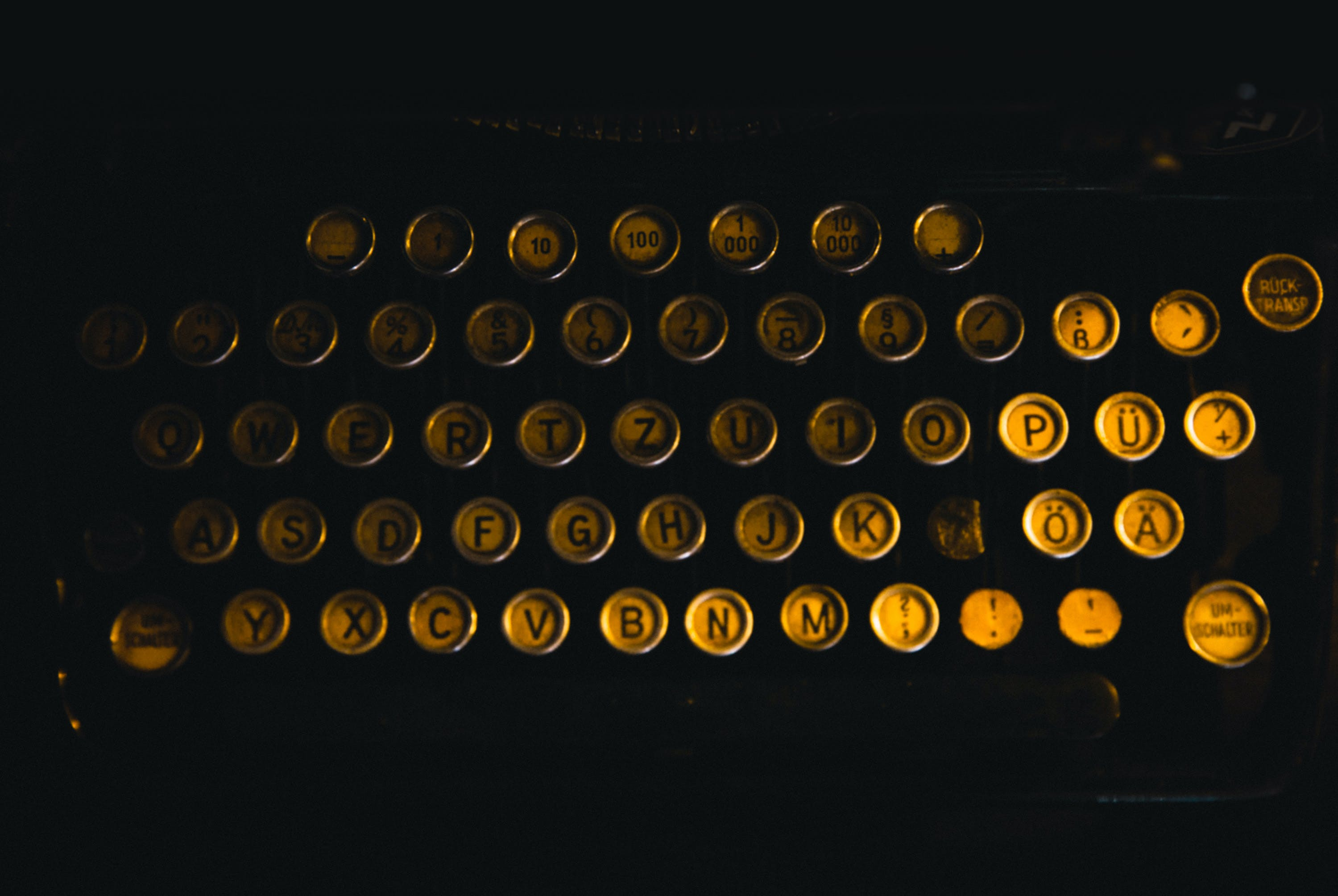 Flat Lay Photography of Brass-colored Typewriter