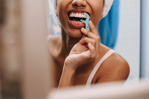 Reflection of woman cleaning teeth