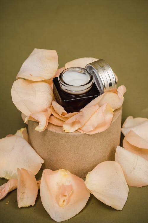 Aroma candle decorated with rose petals