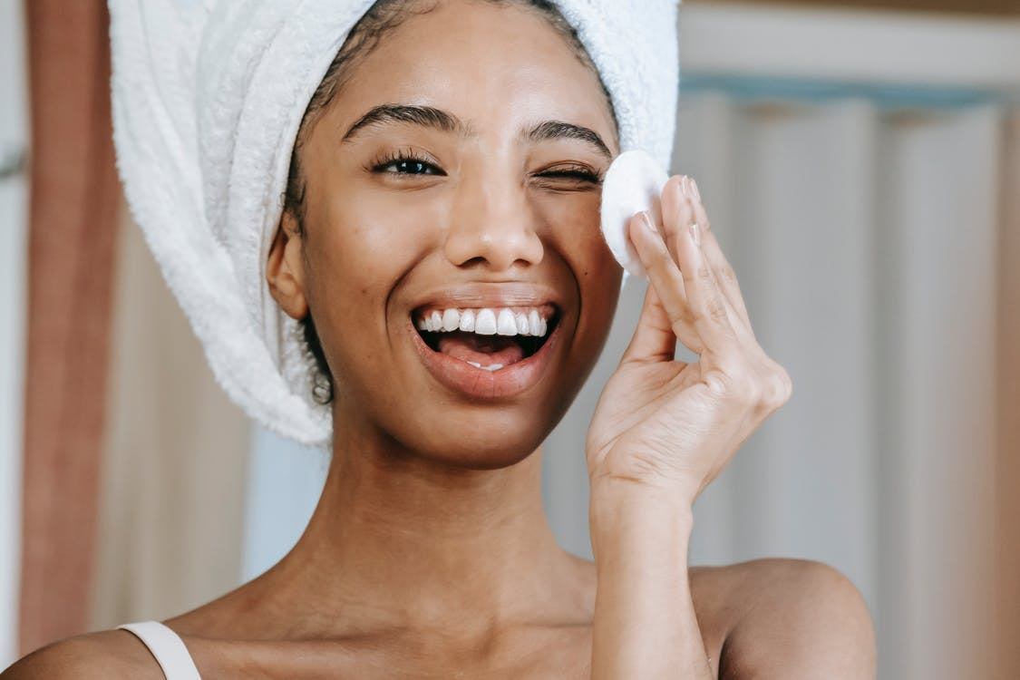 Smiling Woman With White Towel on Head
