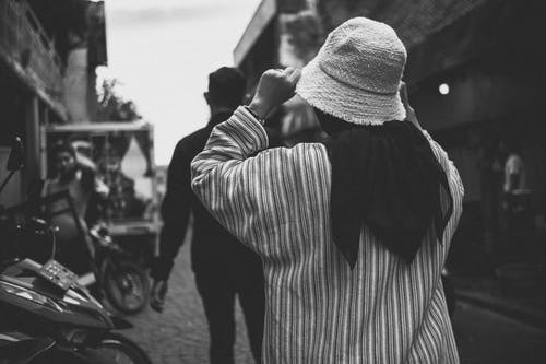 Man and Woman Walking in Grayscale Photography