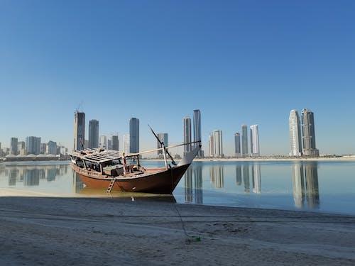 Brown Boat on Sea Shore